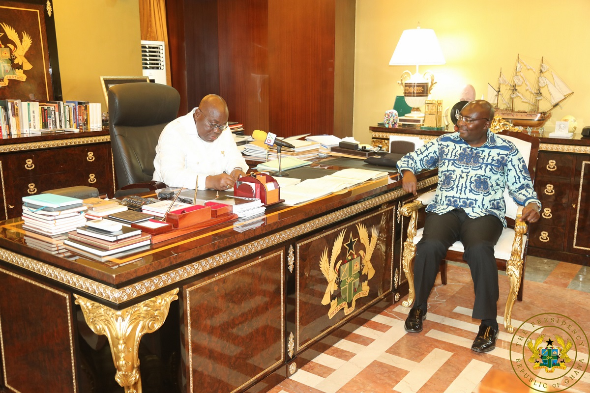 President Akufo-Addo signing the five bills