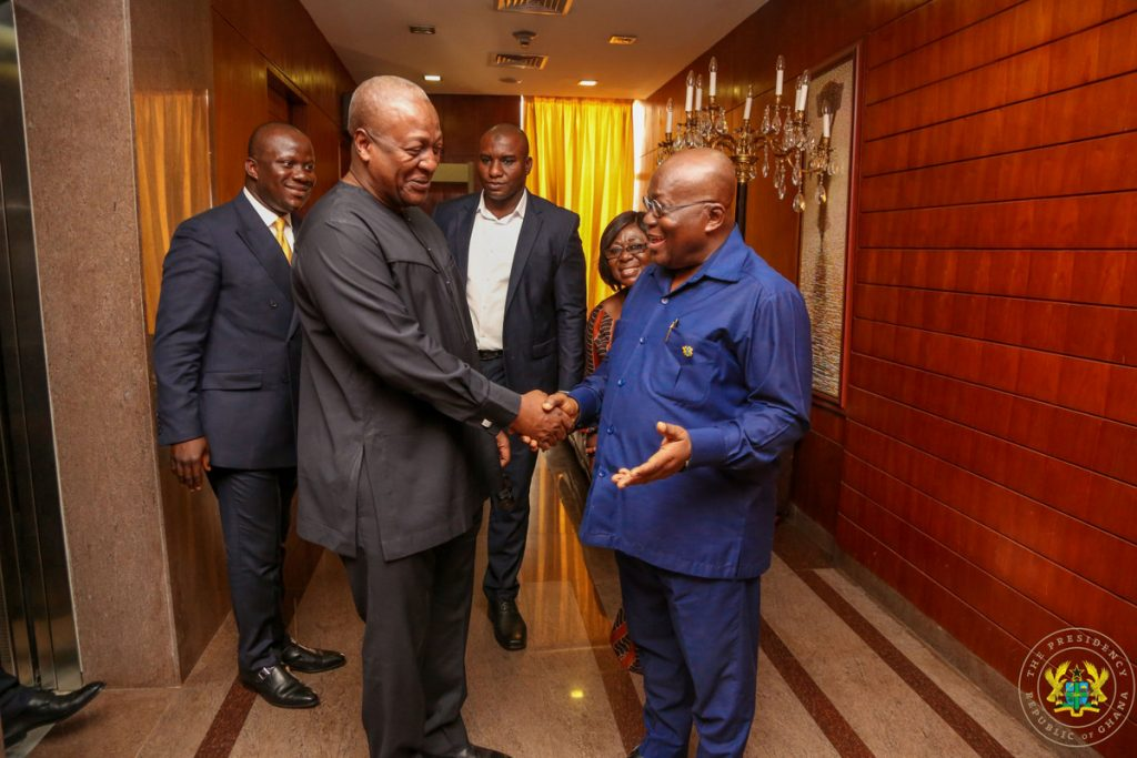 Mr. John Mahama in a chat with President Akufo-Addo