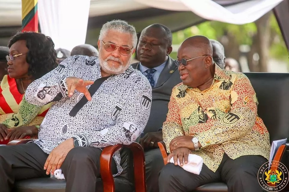 Former president Rawlings and Akufo-Addo interacting at an event