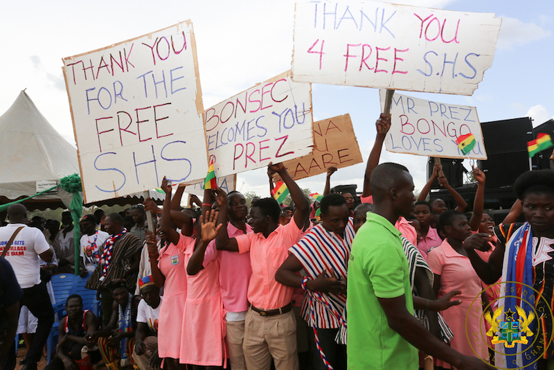 Students brandishing placards in praise of Free SHS