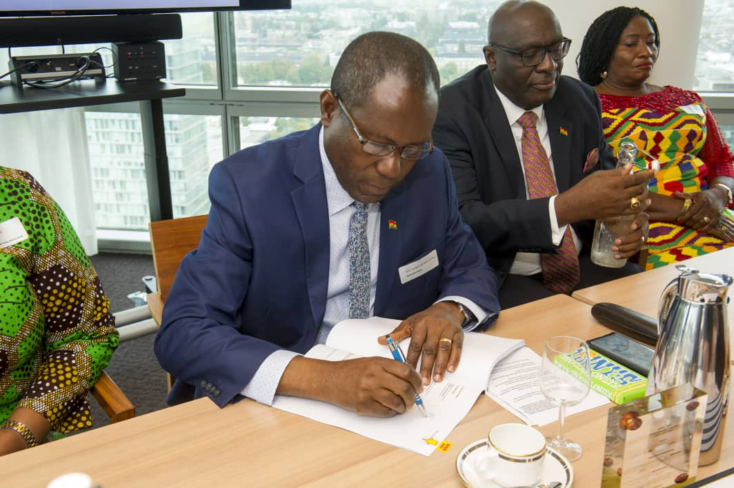 Cocobod CEO Joseph Boahene Aidoo signing the deal