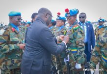 Dr. Bawumia pinning medals on troops at a colourful ceremony