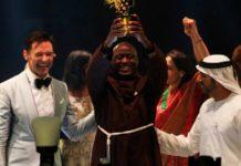 Kenyan teacher Peter Tabichi, center, actor Hugh Jackman, left, and Dubai crown prince Sheikh Hamdan bin Mohammed Al Maktoum react after Tabichi won the $1 million Global Teacher Prize in Dubai, United Arab Emirates.